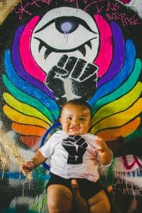 baby with rainbow grafitti